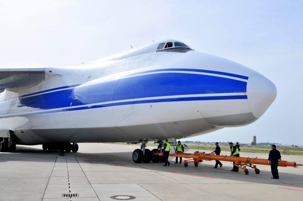 An-124's massive size offers several heavy lift capabilities – roll-on, roll-off ramps for cargo fore and aft, built-in freight handling equipment - internal cranes for run along the roof to manipulate large and unusually sized cargo and front-end kneeling for easier loading.